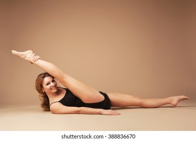 Beautiful sporty woman doing exercise. The split