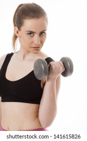 Beautiful sporty woman with dumbbells