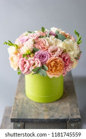 Beautiful spring bouquet in head box. Arrangement with mix flowers. The concept of a flower shop, a small family business. Work florist.
