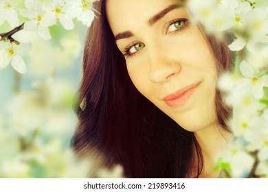Beautiful Spring Brunette Girl with flowers.