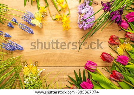 Beautiful Spring Flowers Butterflies Arranged Around Stock Photo