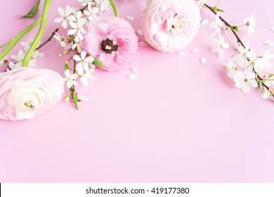 beautiful spring flowers at pink background.frame composition