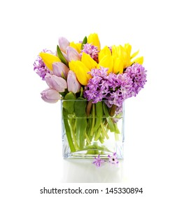 Beautiful spring flowers in vase over white
