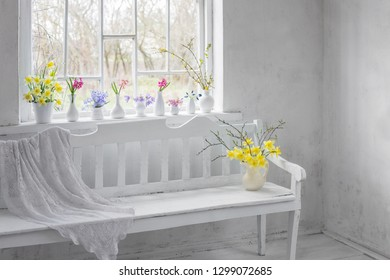 beautiful spring flowers in white vintage interior
