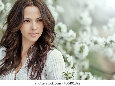 Beautiful spring girl in blooming tree