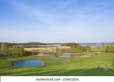 Beautiful spring landscape - top view of lakes and hills of Masuria District, Oswin Lake, Poland