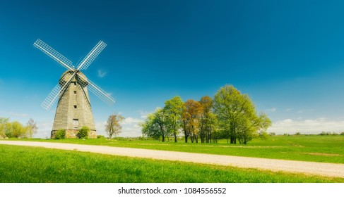 beautiful spring landscape of wind mil , green grass and blue sky