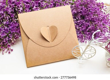 Beautiful spring lilac little white bike and gift box on a background