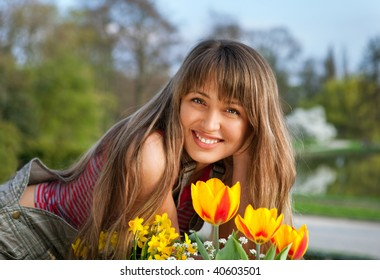 beautiful spring portrait with tulips of blond girl
