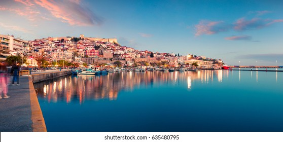Beautiful spring seascape on Aegean Sea. Colorful evening panorama of Kavala city, the principal seaport of eastern Macedonia and the capital of Kavala regional unit. Greece, Europe.