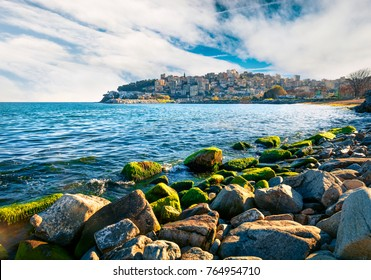 Beautiful spring seascape on Aegean Sea. Coloful morning view of Kavala city; the principal seaport of eastern Macedonia and the capital of Kavala regional unit. Greece; Europe.