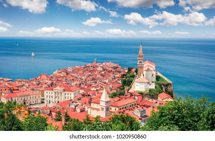 Beautiful spring view of old town Piran. Colorful morning seascape of Adriatic Sea. Beautiful cityscape of Slovenia, Europe. Traveling concept background. Orton Effect.