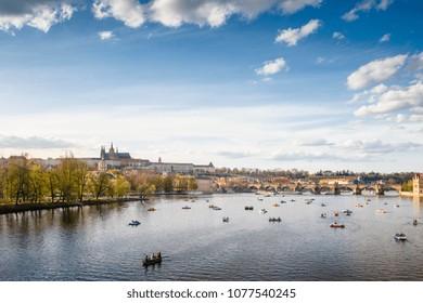 Beautiful spring view on Prague Castle and tourist boats, Prague, Czech Republic