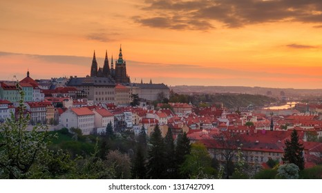 A beautiful spring view of Prague at sunrise from Petrin hill. Prague Castle and St. Vitus Cathedral on the left side.