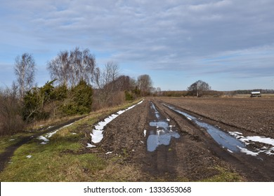 Beautiful springtime view with melting snow in a farmers field at the swedish island Oland