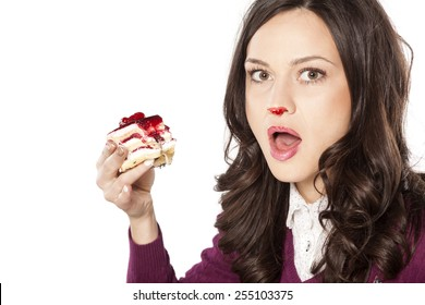Beautiful stained girl has been caught while eating cake
