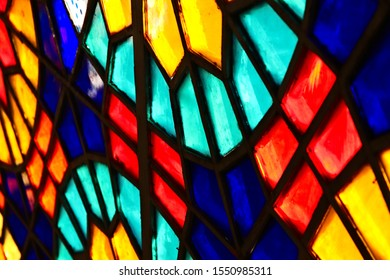 A beautiful stained glass window frame inside a church.