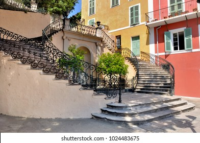 Beautiful staircase on a square of bastia in Corsica in front of colored building