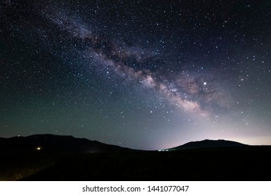 Beautiful starry night. Bright milky way galaxy over the hills.