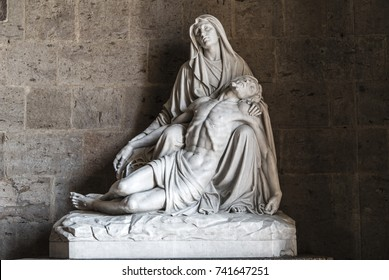 beautiful statue of Holy Mary holding the Corpus Christi on her lap