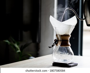 beautiful steam when brewing coffee. specialty coffee, a third-wave coffee shop. Coffee and coronavirus