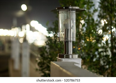 Beautiful steel  fence with with posts and lamps on boken blurry abstract beautiful color light