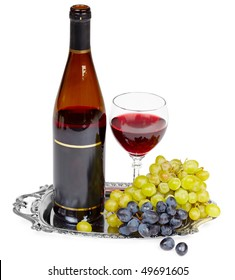 Beautiful still life - a bottle of wine, glass and grapes on a metal tray