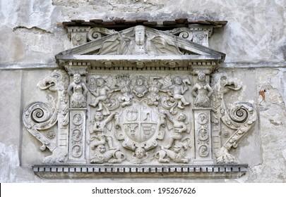 Beautiful stone bas-relief over door (Olesko Castle, Lvivska Region, Ukraine, built before 1390)