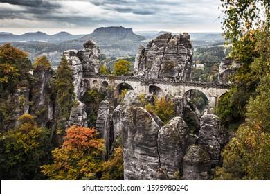 Beautiful stone bastion bridge in Saxon Switzerland in colourful autumn