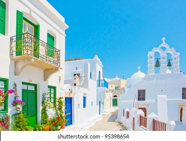 Beautiful stone made road with old traditional houses and a twin church in Chora the capital of Amorgos island in Greece
