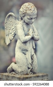 Beautiful stone statue of praying angel