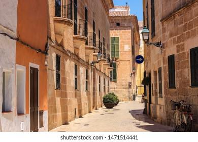 Beautiful stone street of Ciutadella town in hot summer noon, Ciutadella, Menorca, Spain