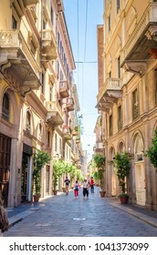 Beautiful street with ancient buildings in the center of Milan, Italy