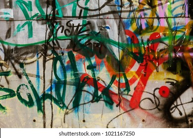 Beautiful street art. Abstract creative drawings of fashionable colors on the walls of the city. Urban contemporary culture. Abstract stylish drawing, label on the wall, fragment of graffiti