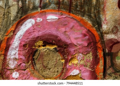 Beautiful street art graffiti. Abstract creative drawings of fashionable colors on the walls of the city. Urban contemporary culture. Abstract stylish drawing, label on the wall, fragment of graffiti