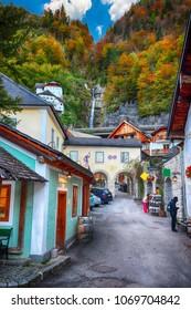 Beautiful street in Hallstatt village in Austrian Alps. Autumn landscape. Location: resort village Hallstatt, Salzkammergut region, Austria, Alps. Europe.