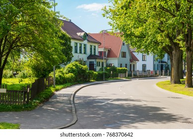 beautiful street with modern residential houses in summer sunny day
