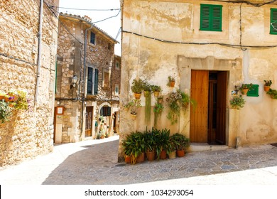 Beautiful street in Valldemossa with traditional flower decoration, famous old mediterranean village of Majorca. Balearic island Mallorca, Spain.