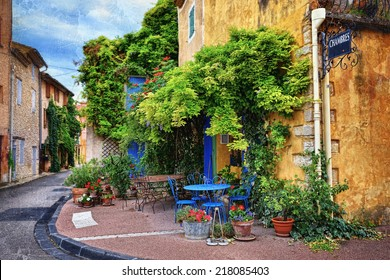 Beautiful street in Villes-sur-Auzon, Provence, France. Filtered image, vintage effect applied