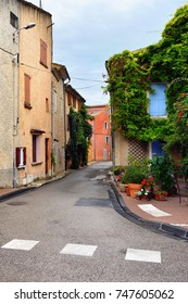 Beautiful street in Villes-sur-Auzon shown after rain on a warm summer evening, Provence, France.
