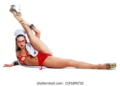 beautiful  striptease dancer, dressed as a nurse  isolated against white background