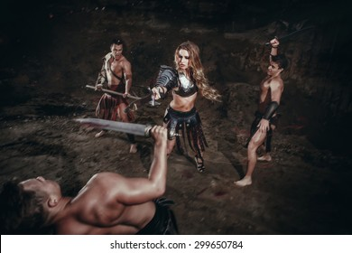 Beautiful strong female of gladiator in battle. Ancient times. Amazon.