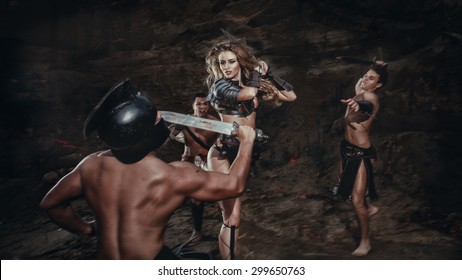 Beautiful strong girl gladiator with sword fights a warrior. Ancient Rome