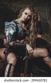 Beautiful strong woman in the image of the warrior gladiator  of the antiquity