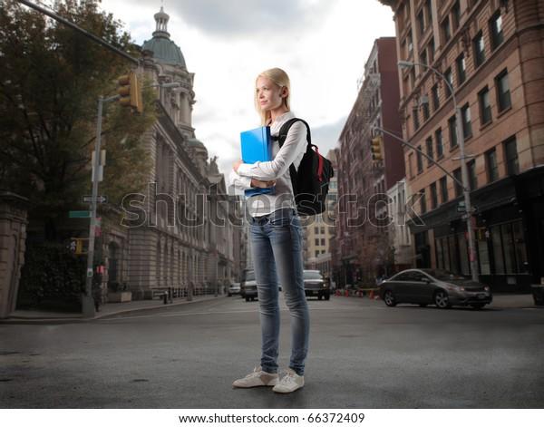 Beautiful student on a city street