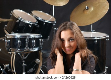 Beautiful student on the drums lesson.