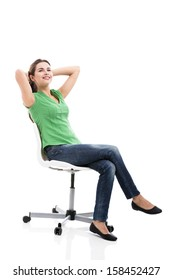 Beautiful student sitting on a chair, isolated over a white background