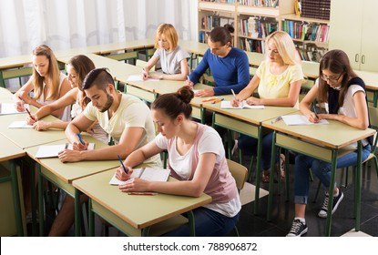Beautiful students studying in the classroom