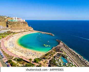 Beautiful stunning aerial view of the Playa de Amadores beach on Gran Canaria island in Spain near Tenerife island.