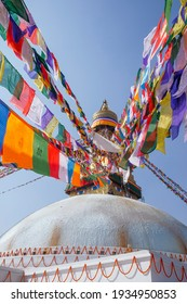 beautiful stupa with colourful prayer flags hanging from its apex at the Boudhanath temple in central Kathmandu, Nepal.